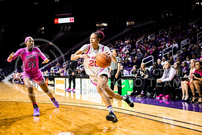Senior forward Jasauen Beard charges the basket during K-State's women's basketball team's Play 4 Kay Pink Game to promote cancer awareness. K-State played against TCU in Bramlage Coliseum on Feb. 19, 2020. The Horned Frogs defeated the Wildcats 54-52. (Logan Wassall | Collegian Media Group)