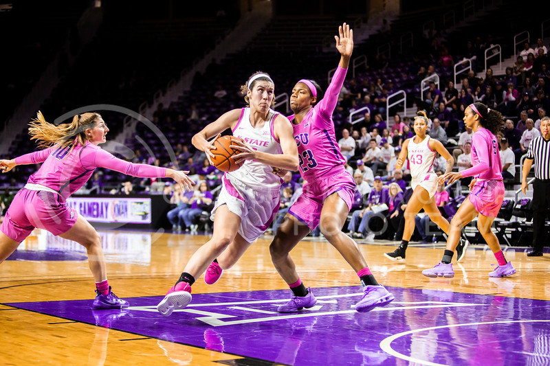 Senior forward Peyton Williams charges the basket for a layup during K-State's women's basketball team's Play 4 Kay Pink Game to promote cancer awareness. K-State played against TCU in Bramlage Coliseum on Feb. 19, 2020. The Horned Frogs defeated the Wildcats 54-52. (Logan Wassall | Collegian Media Group)