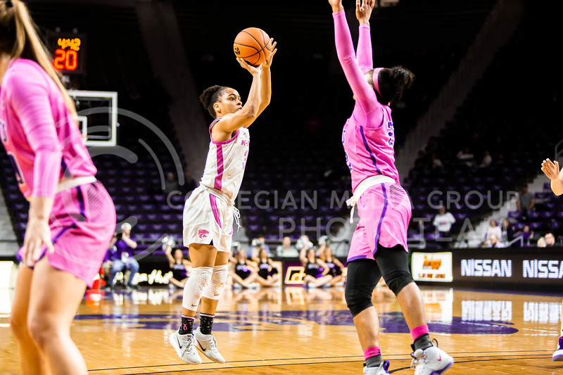 Senior guard Angela Harris leaps up for a shot during K-State's women's basketball team's Play 4 Kay Pink Game to promote cancer awareness. K-State played against TCU in Bramlage Coliseum on Feb. 19, 2020. The Horned Frogs defeated the Wildcats 54-52. (Logan Wassall | Collegian Media Group)