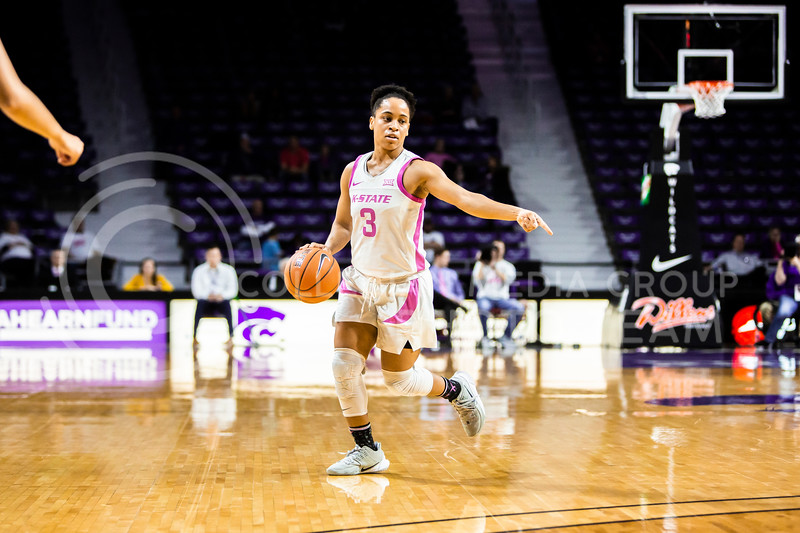 Senior guard Angela Harris calls out a play during K-State's women's basketball team's Play 4 Kay Pink Game to promote cancer awareness. K-State played against TCU in Bramlage Coliseum on Feb. 19, 2020. The Horned Frogs defeated the Wildcats 54-52. (Logan Wassall | Collegian Media Group)