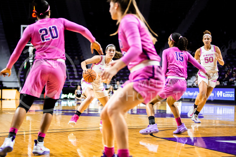 Senior forward Peyton Williams drives towards the basket during K-State's women's basketball team's Play 4 Kay Pink Game to promote cancer awareness. K-State played against TCU in Bramlage Coliseum on Feb. 19, 2020. The Horned Frogs defeated the Wildcats 54-52. (Logan Wassall | Collegian Media Group)