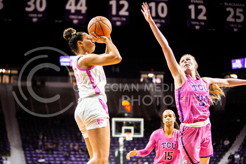 Sophomore guard Christianna Carr leaps back for a shot during K-State's women's basketball team's Play 4 Kay Pink Game to promote cancer awareness. K-State played against TCU in Bramlage Coliseum on Feb. 19, 2020. The Horned Frogs defeated the Wildcats 54-52. (Logan Wassall | Collegian Media Group)