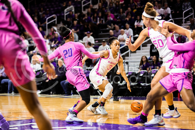 Senior guard Angela Harris dribbles down the court during K-State's women's basketball team's Play 4 Kay Pink Game to promote cancer awareness. K-State played against TCU in Bramlage Coliseum on Feb. 19, 2020. The Horned Frogs defeated the Wildcats 54-52. (Logan Wassall | Collegian Media Group)