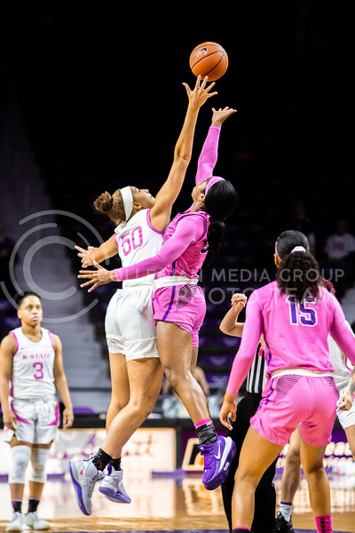 Freshman center Ayoka Lee leaps up for the tipoff during K-State's women's basketball team's Play 4 Kay Pink Game to promote cancer awareness. K-State played against TCU in Bramlage Coliseum on Feb. 19, 2020. The Horned Frogs defeated the Wildcats 54-52. (Logan Wassall | Collegian Media Group)