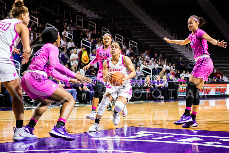 Senior guard Angela Harris charges the basket during K-State's women's basketball team's Play 4 Kay Pink Game to promote cancer awareness. K-State played against TCU in Bramlage Coliseum on Feb. 19, 2020. The Horned Frogs defeated the Wildcats 54-52. (Logan Wassall | Collegian Media Group)