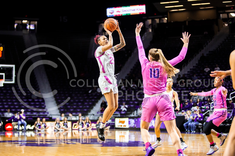 Senior forward Jasauen Beard leaps back for a shot during K-State's women's basketball team's Play 4 Kay Pink Game to promote cancer awareness. K-State played against TCU in Bramlage Coliseum on Feb. 19, 2020. The Horned Frogs defeated the Wildcats 54-52. (Logan Wassall | Collegian Media Group)