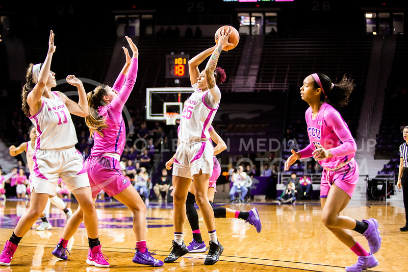 Senior forward Jasauen Beard looks across the court for an open play during K-State's women's basketball team's Play 4 Kay Pink Game to promote cancer awareness. K-State played against TCU in Bramlage Coliseum on Feb. 19, 2020. The Horned Frogs defeated the Wildcats 54-52. (Logan Wassall | Collegian Media Group)