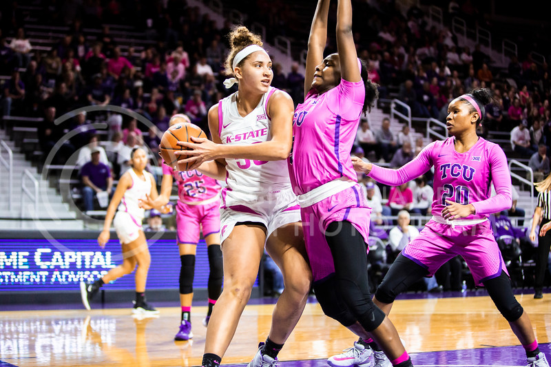 Freshman center Ayoka Lee looks for an open play during K-State's women's basketball team's Play 4 Kay Pink Game to promote cancer awareness. K-State played against TCU in Bramlage Coliseum on Feb. 19, 2020. The Horned Frogs defeated the Wildcats 54-52. (Logan Wassall | Collegian Media Group)