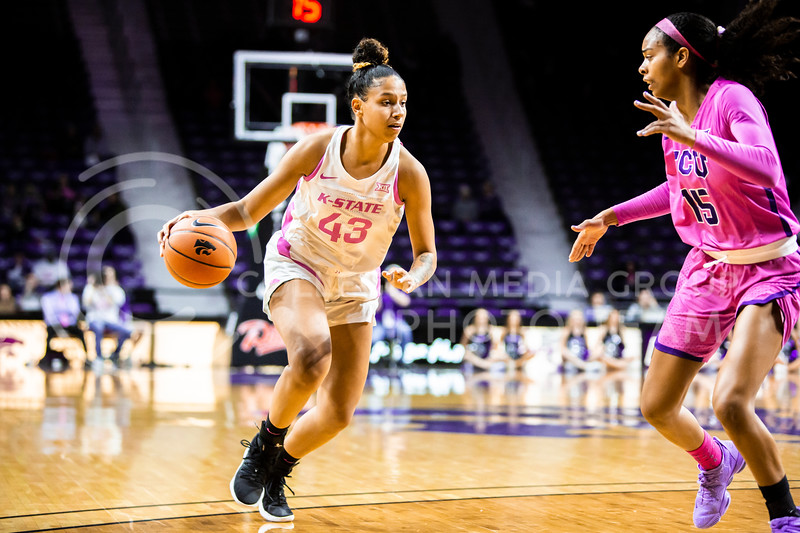 Sophomore guard Christianna Carr dribbles towards the basket during K-State's women's basketball team's Play 4 Kay Pink Game to promote cancer awareness. K-State played against TCU in Bramlage Coliseum on Feb. 19, 2020. The Horned Frogs defeated the Wildcats 54-52. (Logan Wassall | Collegian Media Group)