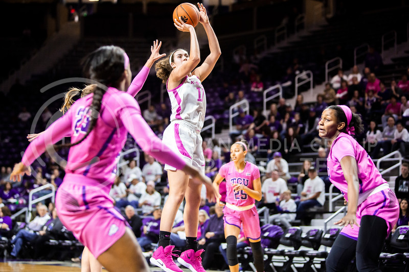 Senior forward Peyton Williams leaps up for a shot during K-State's women's basketball team's Play 4 Kay Pink Game to promote cancer awareness. K-State played against TCU in Bramlage Coliseum on Feb. 19, 2020. The Horned Frogs defeated the Wildcats 54-52. (Logan Wassall | Collegian Media Group)
