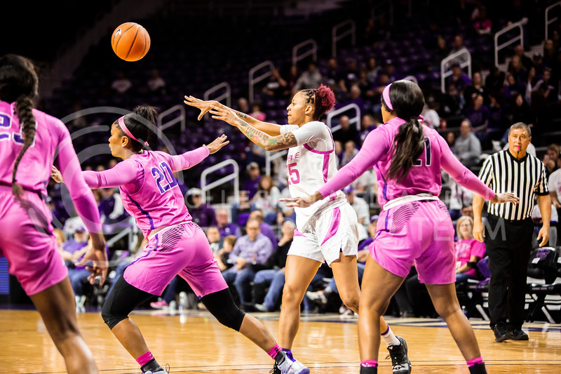 Senior forward Jasauen Beard passes the ball during K-State's women's basketball team's Play 4 Kay Pink Game to promote cancer awareness. K-State played against TCU in Bramlage Coliseum on Feb. 19, 2020. The Horned Frogs defeated the Wildcats 54-52. (Logan Wassall | Collegian Media Group)