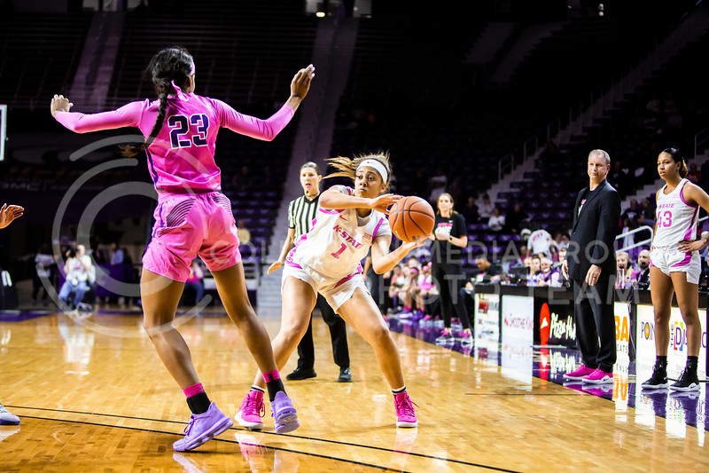 Sophomore guard Savannah Simmons passes the ball during K-State's women's basketball team's Play 4 Kay Pink Game to promote cancer awareness. K-State played against TCU in Bramlage Coliseum on Feb. 19, 2020. The Horned Frogs defeated the Wildcats 54-52. (Logan Wassall | Collegian Media Group)
