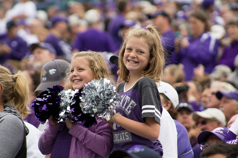 Fans shake their pom-poms while watching in the stands at Bill Snyder Family Stadium on Sept. 8, 2018. The Wildcats lost to the MSU Bulldogs 31-10. (Andrea Klepper | Collegian Media Group)