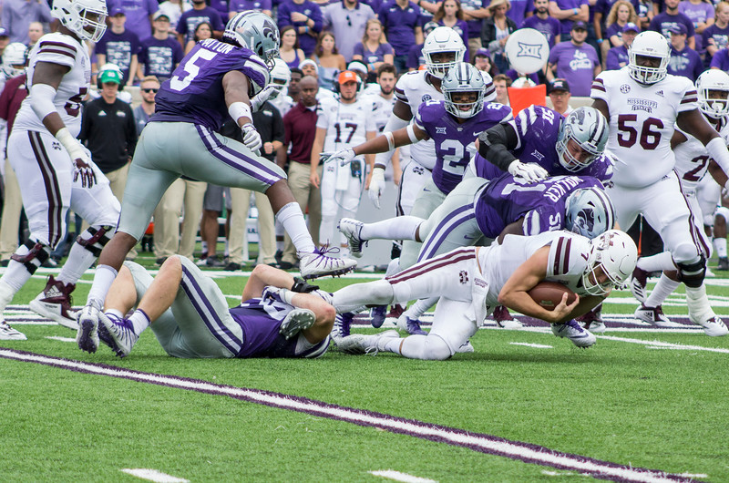 Reggie Walker, Kansas State junior defensive end makes a tackle against Mississippi State at Bill Snyder Family Stadium on Sept. 8, 2018. The Wildcats lost to the MSU Bulldogs 31-10. (Andrea Klepper | Collegian Media Group)