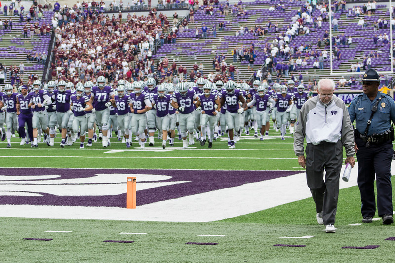 Head coach Bill Snyder leads his players back to the locker room after the game at Bill Snyder Family Stadium on Sept. 8, 2018. The Wildcats lost to the MSU Bulldogs 31-10. (Andrea Klepper | Collegian Media Group)