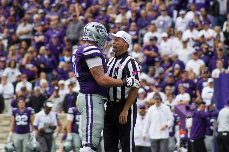 Dalton Risner, Kansas State senior offensive lineman talks with a referee as a timeout is called at Bill Snyder Family Stadium on Sept. 8, 2018. The Wildcats lost to the MSU Bulldogs 31-10. (Andrea Klepper | Collegian Media Group)
