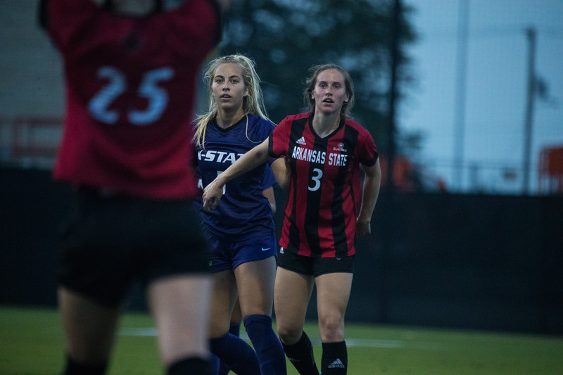 Freshmen Caylee Thornhill prepares to intercept ball while being guarded by Arkansas State Player at game against Arkansas State. Arkansas won 2-1