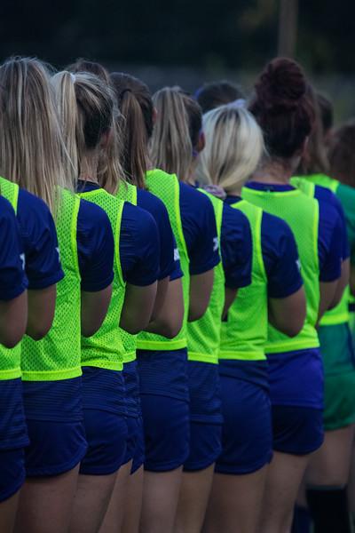 KSU soccer team lined up during national anthem at game against Arkansas State. Arkansas won 2:1