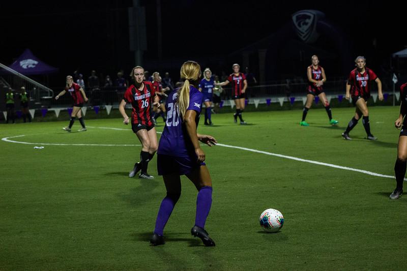 Senior Katie Cramer looking up to see where to pass the ball at game against Arkansas State. Arkansas won 2-1. (Luis Villarreal-Reyes   Collegian Media Group)