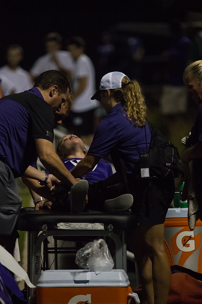 Junior Hannah Davis lays on bed on the sidelines after getting injured at game against Arkansas State. Arkansas won 2:1