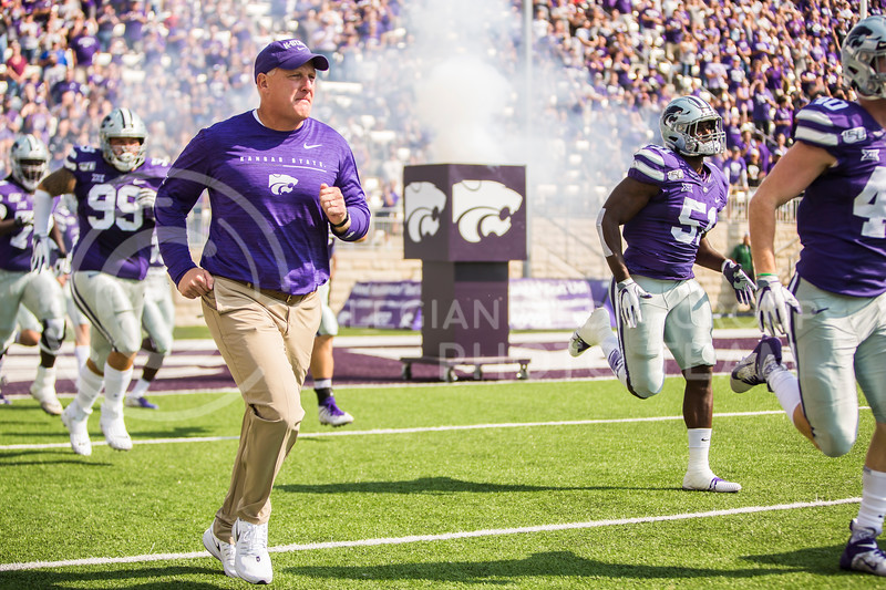 Chris Klieman runs on the field before K-State's football game against Bowling Green in Bill Snyder Family Stadium on Sept. 7, 2019. The Wildcats shut down the Falcons with a final score of 52-0. (Logan Wassall | Logan Wassall Collegian Media Group)