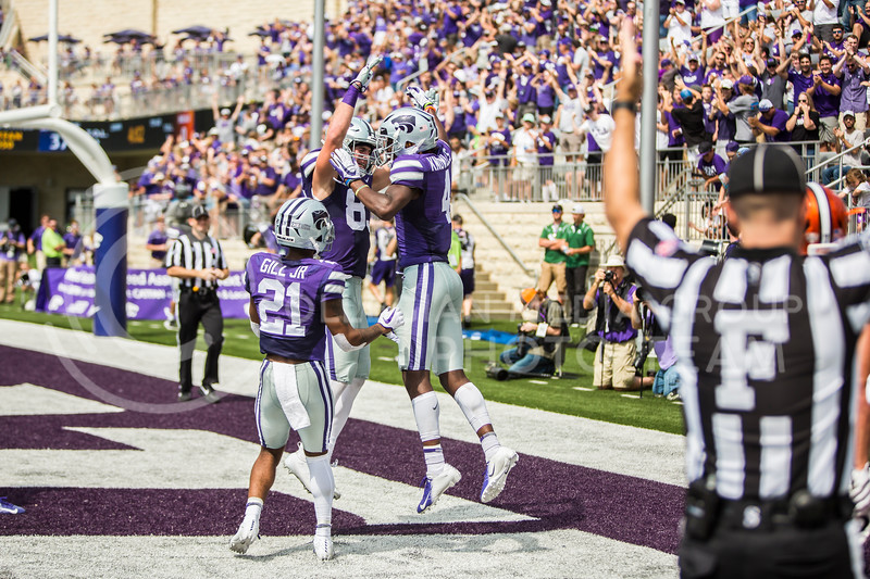 K-State's football team celebrates togethere after a touchdown during their game against Bowling Green in Bill Snyder Family Stadium on Sept. 7, 2019. The Wildcats shut down the Falcons with a final score of 52-0. (Logan Wassall | Logan Wassall Collegian Media Group)