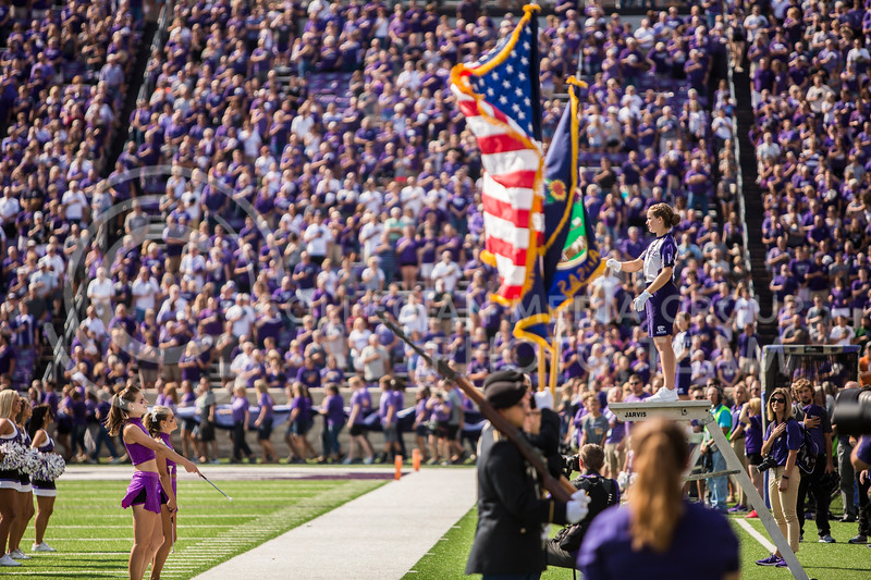 Senior drum major Madison Hines leads K-State's marching band in performing before the football game against Bowling Green in Bill Snyder Family Stadium on Sept. 7, 2019. The Wildcats shut down the Falcons with a final score of 52-0. (Logan Wassall | Logan Wassall Collegian Media Group)