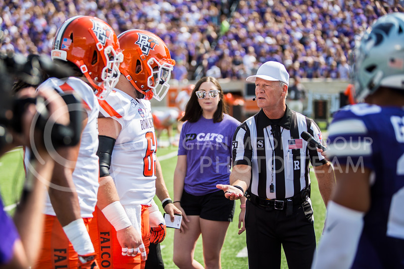 K-State and Bowling Green's team captiains approach midfield for the coin toss before their football game in Bill Snyder Family Stadium on Sept. 7, 2019. The Wildcats shut down the Falcons with a final score of 52-0. (Logan Wassall | Logan Wassall Collegian Media Group)