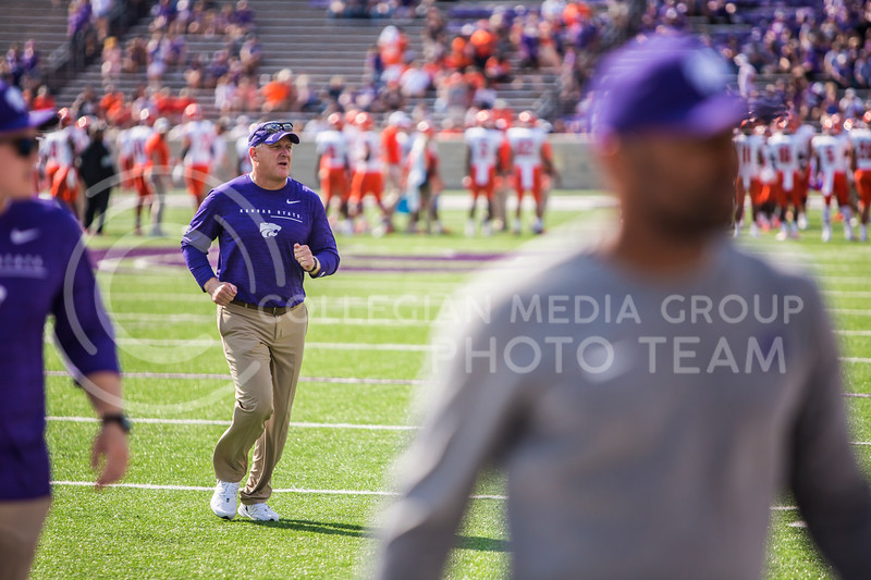 Chris Klieman runs off the field before K-State's football game against Bowling Green in Bill Snyder Family Stadium on Sept. 7, 2019. The Wildcats shut down the Falcons with a final score of 52-0. (Logan Wassall | Logan Wassall Collegian Media Group)