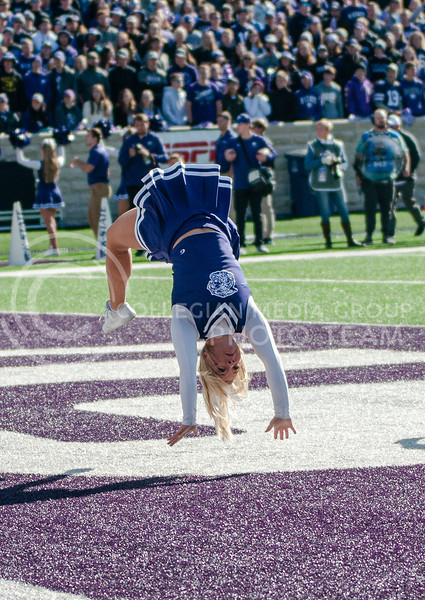 Celebrating a touchdown, cheerleaders flip across the field during K-State's homecoming game against OU on Oct. 26th, 2019. The Wildcats defeated the Sooners 48-41.  (Aubrey Bolinger | Collegian Media Group)