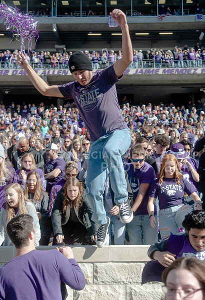 Storming the field, the fans celebrate the homecoming victory against OU on Oct. 26th, 2019. The Wildcats defeated the Sooners 48-41. (Aubrey Bolinger | Collegian Media Group)