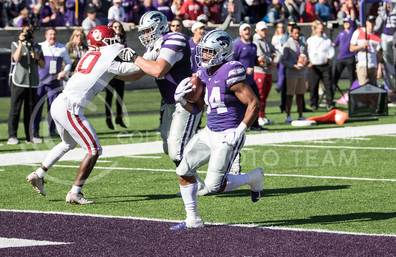 Senior running back James Gilbert rushes into the end zone for a touchdown during the game against Oklahoma at Bill Snyder Family Stadium on Oct. 26, 2019. (Sabrina Cline | Collegian Media Group)