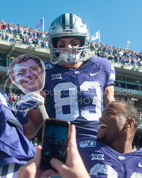 K-State's team celebrates the homecoming victory against OU with fans on Oct. 26th, 2019. The Wildcats defeated the Sooners 48-41. (Aubrey Bolinger | Collegian Media Group)