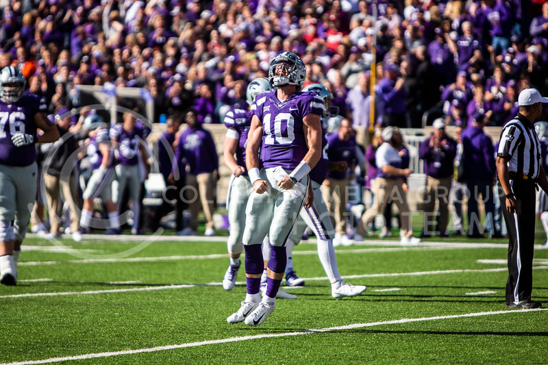 Junior quarterback Skylar Thompson celebrates after running in a touchdown during K-State's homecoming football game against OU in Bill Snyder Family Stadium on Oct. 26, 2019. The Wildcats upset the No. 5 rated Sooners with a final score of 48-41. (Logan Wassall | Collegian Media Group)