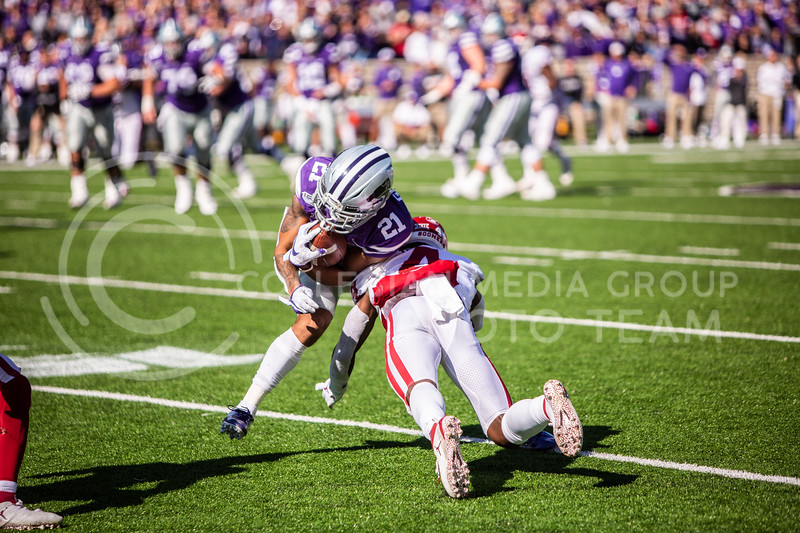 Junior wide receiver Wykeen Gill runs the ball during K-State's homecoming football game against OU in Bill Snyder Family Stadium on Oct. 26, 2019. The Wildcats upset the No. 5 rated Sooners with a final score of 48-41. (Logan Wassall | Collegian Media Group)