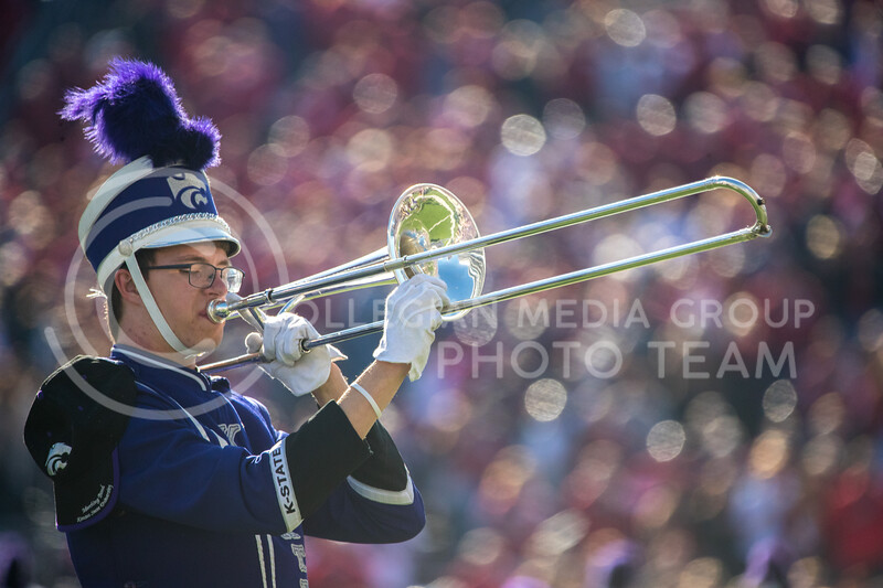 Trombone player plays with Marching band with away team section in the background at game against Oklahoma. The Wildcats upset the #5 ranked Sooners 48-41.( Dalton Wainscott I Collegian Media Group )