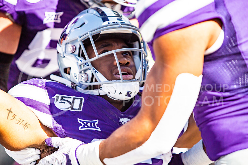 Freshman wide receiver Joshua Youngblood celebrates after running in a touchdown during K-State's homecoming football game against OU in Bill Snyder Family Stadium on Oct. 26, 2019. The Wildcats upset the No. 5 rated Sooners with a final score of 48-41. (Logan Wassall | Collegian Media Group)
