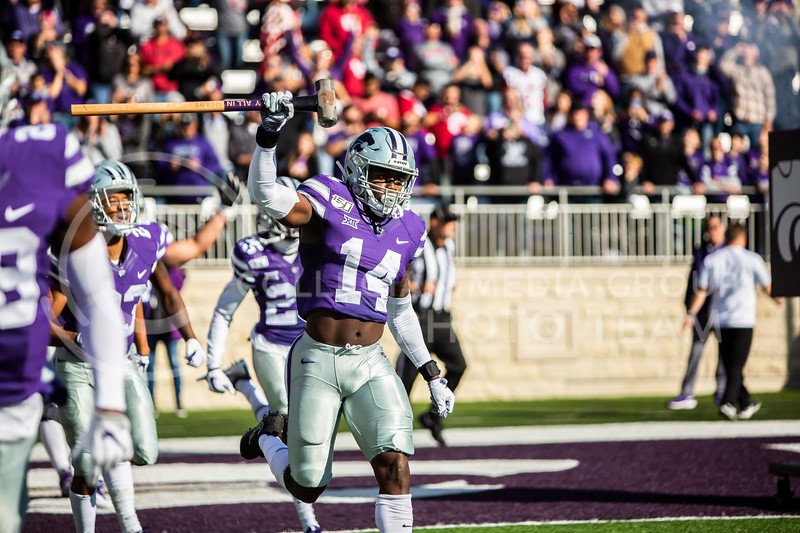 Freshman defensive back Tyrone Lewis runs out onto the field with the rest of K-State's football team before their homecoming football game against OU in Bill Snyder Family Stadium on Oct. 26, 2019. The Wildcats upset the No. 5 rated Sooners with a final score of 48-41. (Logan Wassall | Collegian Media Group)