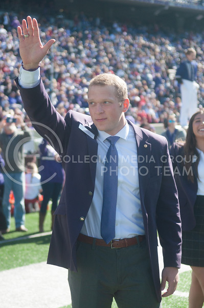 Previous K-State Student Ambassador Tel Whittmer waves to the crowd before learning who the 2020 student ambassadors would be. (Aubrey Bolinger | Collegian Media Group)