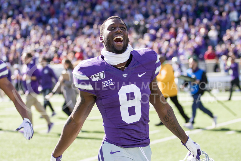 Senior defensive back Daron Bowles celebrates the win over the number five ranked Oklahoma with the student section during the game against Oklahoma at Bill Snyder Family Stadium on Oct. 26, 2019. (Sabrina Cline | Collegian Media Group)