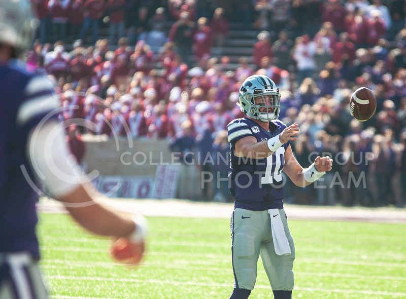 Junior quarterback Skylar Thompson passes the ball to warm up before K-State's homecoming game against OU on Oct. 26th, 2019. The Wildcats defeated the Sooners 48-41. <br /> (Aubrey Bolinger | Collegian Media Group)