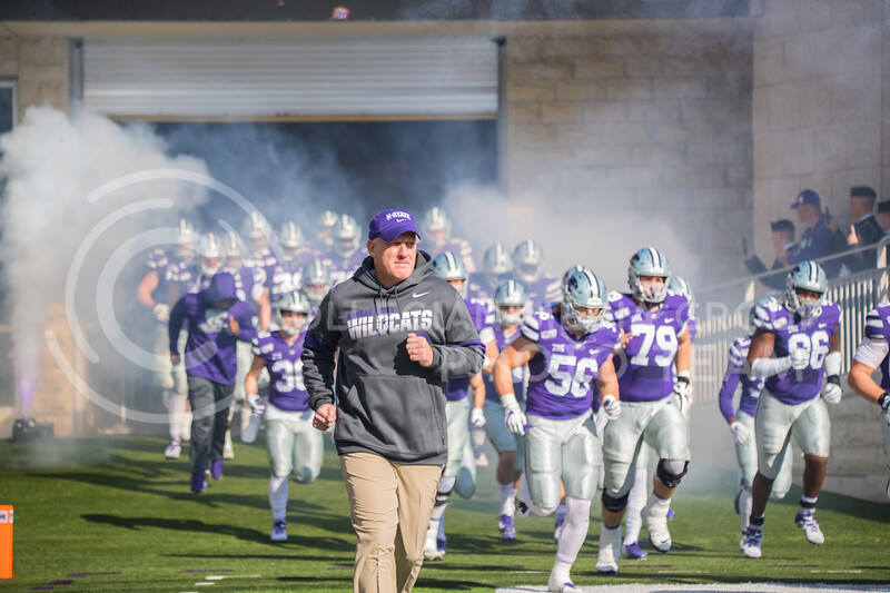 Head Coach Chris Klieman runs out with Wildcats at start of game against Oklahoma. The Wildcats upset the #5 ranked Sooners 48-41.( Dalton Wainscott I Collegian Media Group )