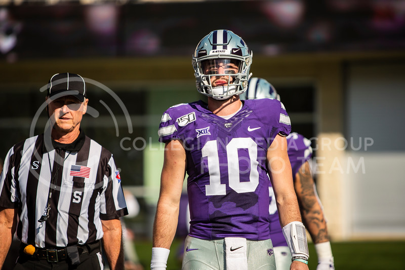 Junior quarterback Skylar Thompson walks out onto the field in preparation for the coin toss before K-State's homecoming football game against OU in Bill Snyder Family Stadium on Oct. 26, 2019. The Wildcats upset the No. 5 rated Sooners with a final score of 48-41. (Logan Wassall | Collegian Media Group)