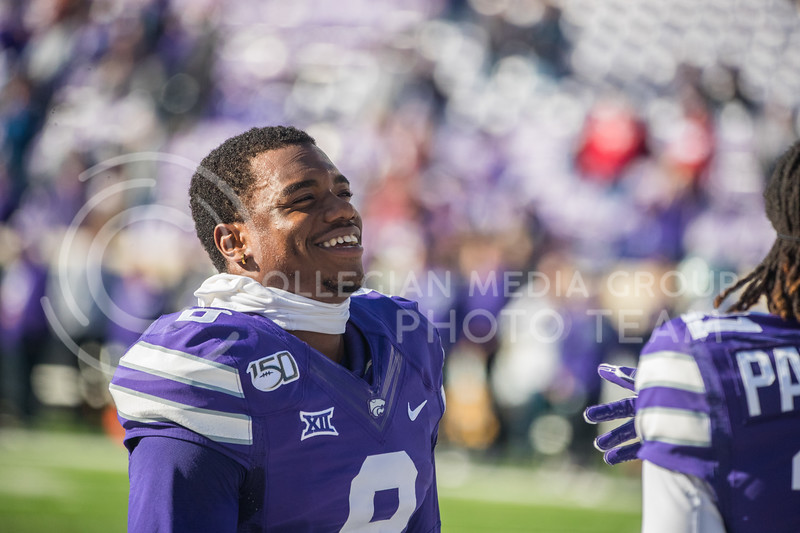 Senior Defensive Back Daron Bowles laughs with teammate before game against Oklahoma. The Wildcats upset the #5 ranked Sooners 48-41. ( Dalton Wainscott I Collegian Media Group )