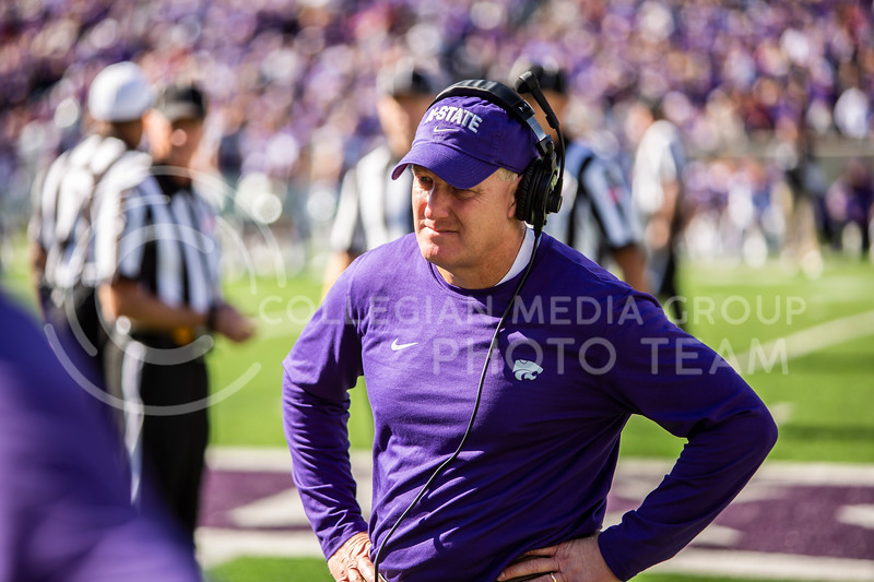 Head coach Chris Klieman waits for injured player Eric Gallon II to be taken off the field after a knee injury during K-State's homecoming football game against OU in Bill Snyder Family Stadium on Oct. 26, 2019. The Wildcats upset the No. 5 rated Sooners with a final score of 48-41. (Logan Wassall | Collegian Media Group)