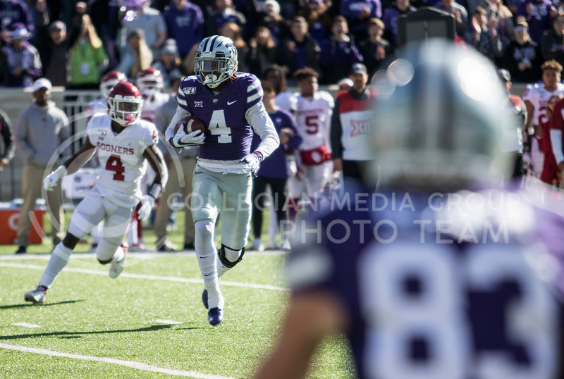 Redshirt freshman wide receiver Malik Knowles catches the pass from Skylar Thompson and runs downfield during the game against Oklahoma at Bill Snyder Family Stadium on Oct. 25, 2019. (Sabrina Cline | Collegian Media Group)