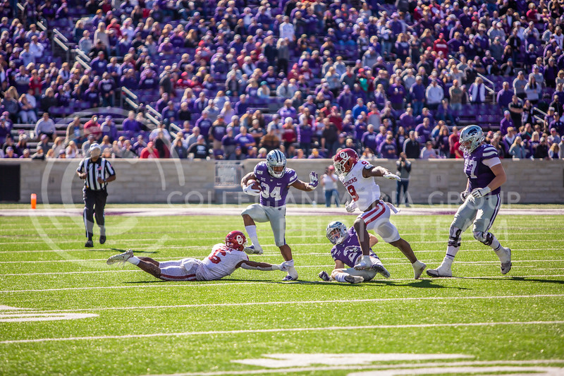 Senior running back James Gilbert runs the ball during K-State's homecoming football game against OU in Bill Snyder Family Stadium on Oct. 26, 2019. The Wildcats upset the No. 5 rated Sooners with a final score of 48-41. (Logan Wassall | Collegian Media Group)