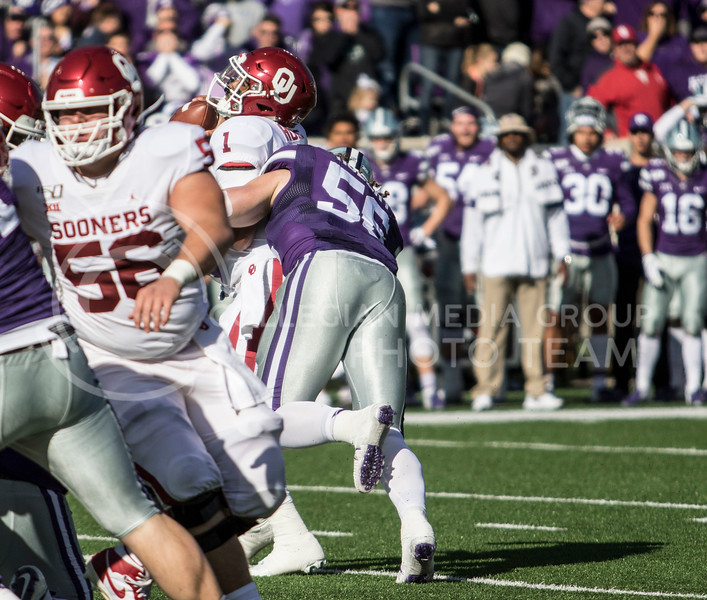 Sophomore defensive end Wyatt Hubert sacks Oklahoma quarterback Jalen Hurts during the game against Oklahoma at Bill Snyder Family Stadium on Oct. 25, 2019. (Sabrina Cline | Collegian Media Group)
