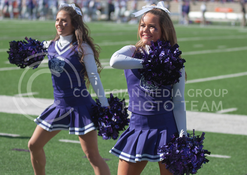 Cheering on the Wildcats, K-States Cheer Team beam at the student section during K-State's homecoming game against OU on Oct. 26th, 2019. The Wildcats defeated the Sooners 48-41. (Aubrey Bolinger | Collegian Media Group)
