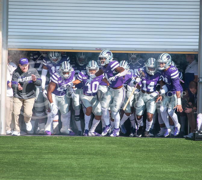 The team storms onto the field before K-State's homecoming game against OU on Oct. 26th, 2019. The Wildcats defeated the Sooners 48-41. <br /> (Aubrey Bolinger | Collegian Media Group)